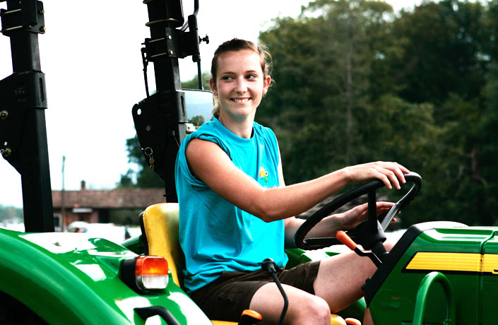 Girl driving a tractor